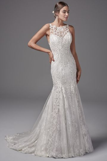 JunoFeaturing layers of lace appliqués, this fit-and-flare evokes sophisticated romance. Chic...