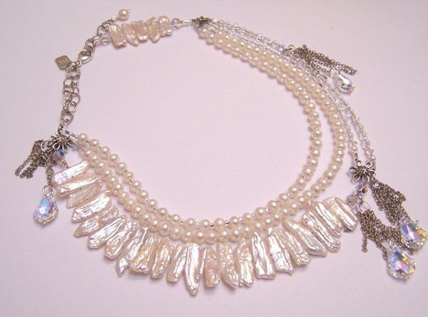 SJD Bridal Couture - Necklace (Limited Edition). The crystals on the left and right symbolize the...
