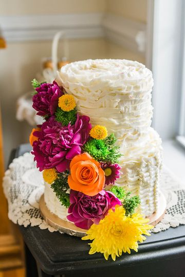 2-tier wedding cake with cascading flowers