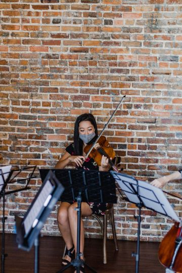 Violist performing at Edison
