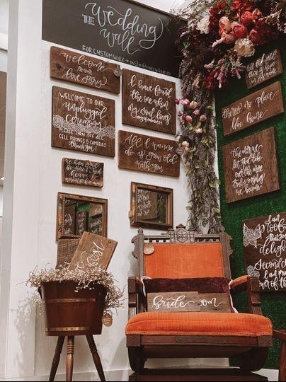 A wall of wedding signage