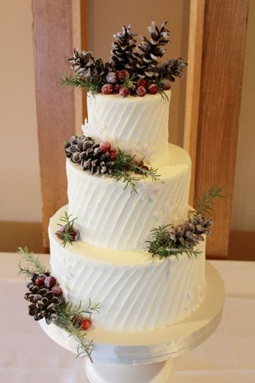 Three tier buttercream diagonal spatula pattern adorned with acorn and fresh berries