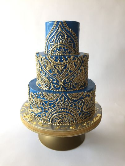 Three tier gold and blue cake