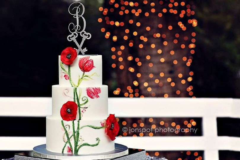Three tier cake with red flowers