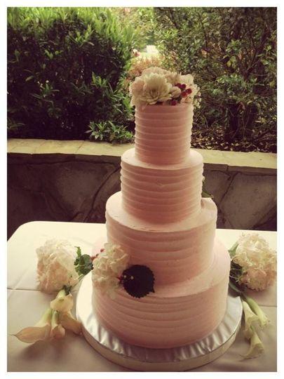 Four tier peach wedding cake