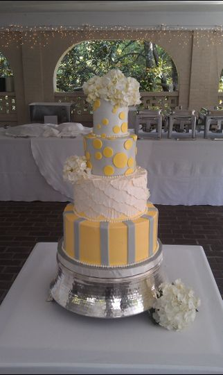 Four tier yellow and grey cake
