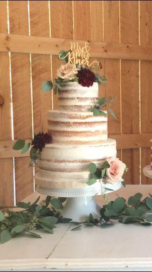 Three tier wedding cake with rose