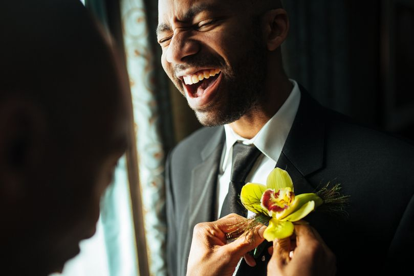 Groom prep boutonniere moment - Stephen Tang Photo