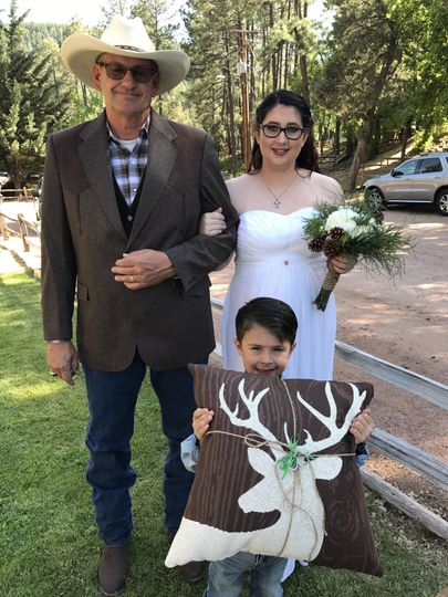 The bride, her father and her ring bearer