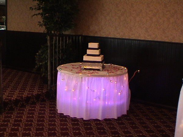 Purple uplights can be used under tables like the cake table or head table.