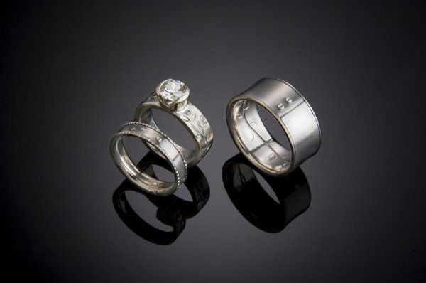 Both Jerry and Heather's rings are made of Titanium and 14k white Gold