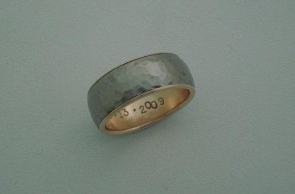 Andres's ring is made of a hammered textured Titanium outer layer and an 18k red (rose) gold liner....