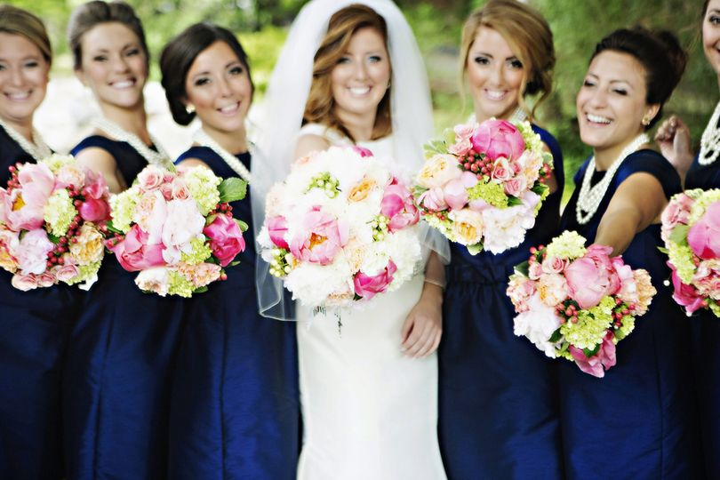 Bride with bridesmaids holding flower