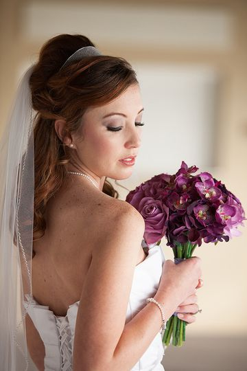 young bride in veil with purple flowers