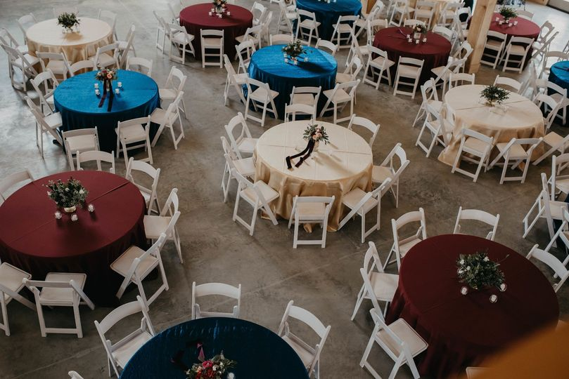 Round tables with multicolored linens
