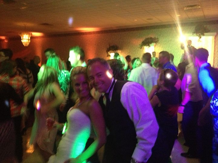 Couple with dancing guests