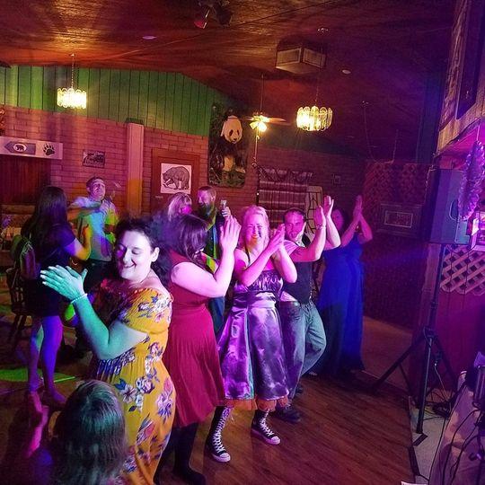 Wedding guests line dancing