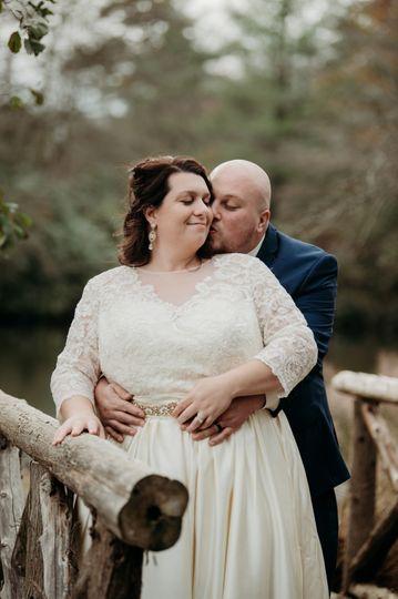 Couple embracing on bridge