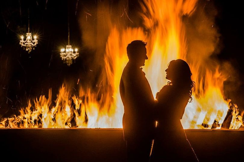 Couple in front of fire pit