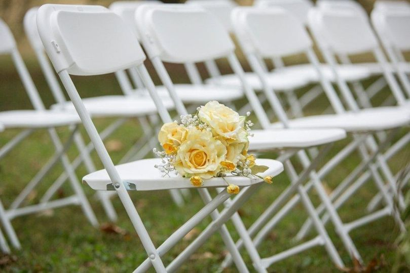 Wedding ceremony chair with bouquet