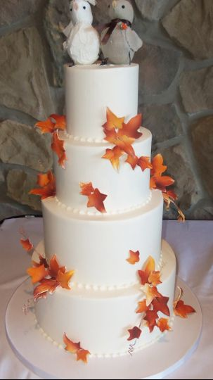 White cake with autumn leaves