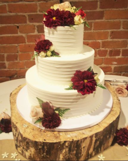 Textured white cake with deep red flowers