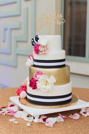 Four tier black, white and gold cake