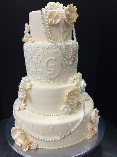 Four tier wedding cake with edible pearls