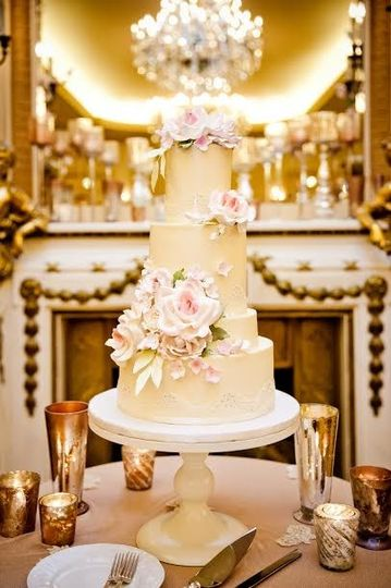 Four tier wedding cake with pink flowers