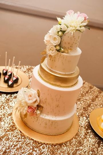 Five tier white and gold cake
