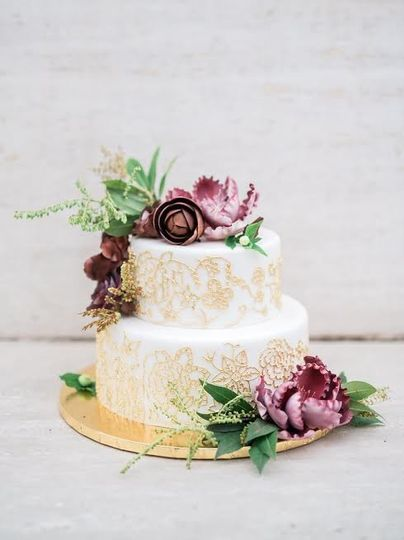 Two tier cake with gold embellishments