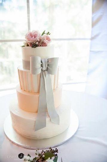 Four tier wedding cake with a grey bow