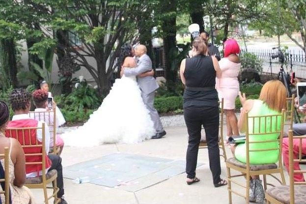 Me taking photos at a wedding