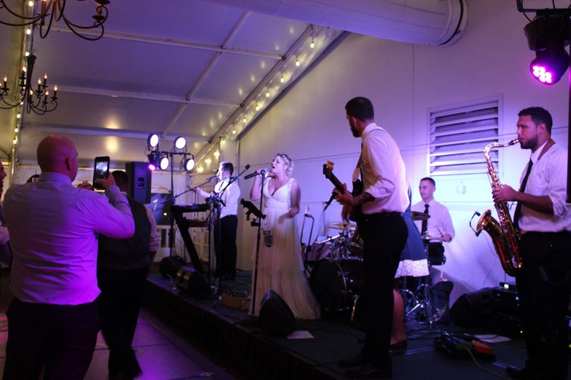 Bride singing with the band