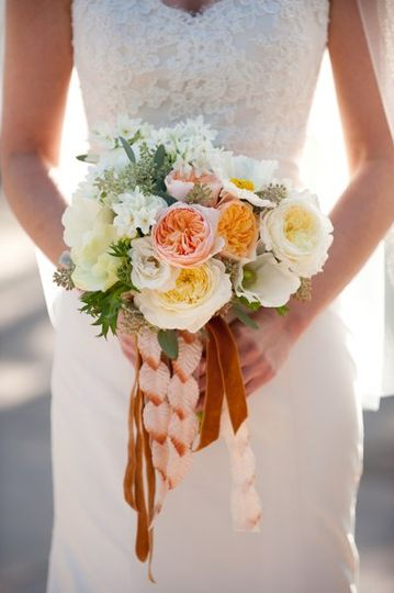 The bride wanted a subtle bouquet in sunset hues that was both lush and romantic.