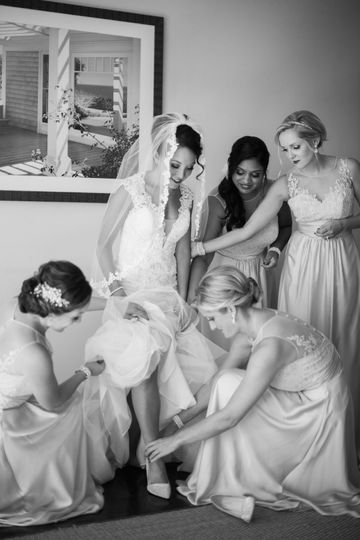 Bride helped by her bridesmaids