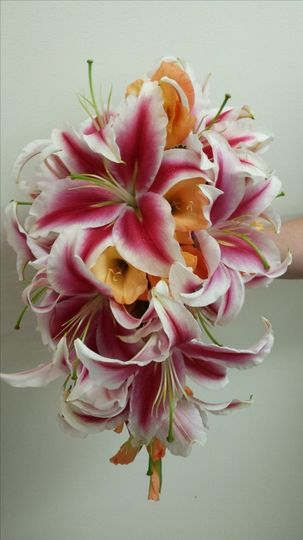 Cascade bouquet - Stargazer lilies, and orange gladiolus. Great for a beach wedding