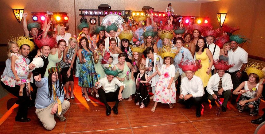 Group Photo after a Conga - Hats & Macaras can be a fun addition for thoes looking for fun &...