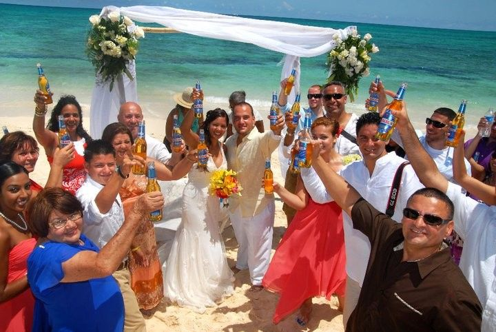 Just married celebration toast with Bahamian beer...Kalik of course.