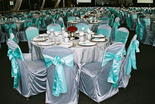 Silver satin covers, tiffany satin ties, and silver bali overlays. Over 1,000 chairs!