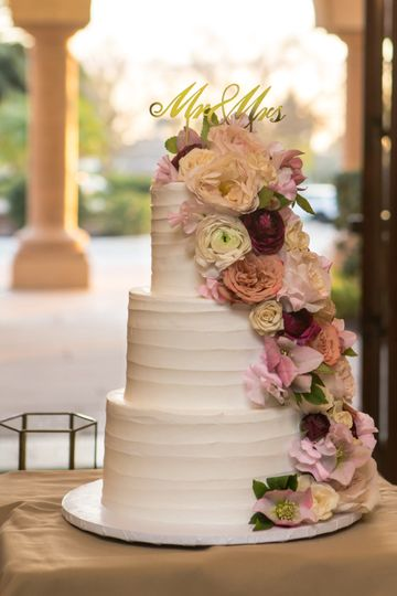 Floral-draped wedding cake - Campbell Family Photography