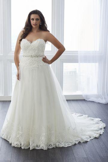 20941e309b8 Christina Wu Love Style 29292 Christina Wu Love Style 29293 Beaded lace  trails down this sheath gown