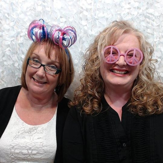 BESTIES love the photo booth!  This is our wedding fluffy background (white)