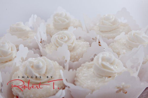 A white cupcake wedding. Several flavors of cupcakes available including red velvet, carrot cake,...