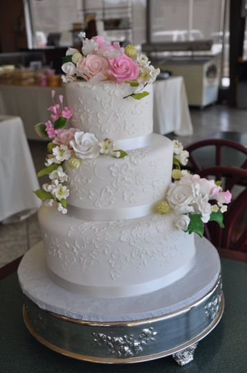 3 layered with white rose decor cake
