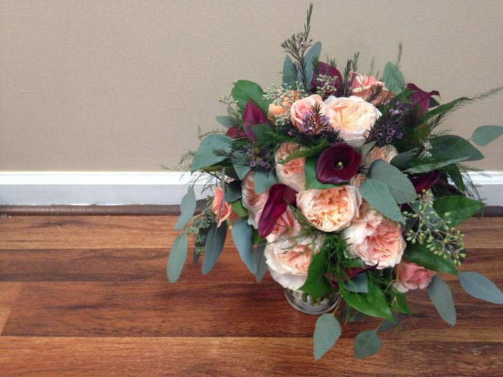 Bouquet of peach and purple flowers