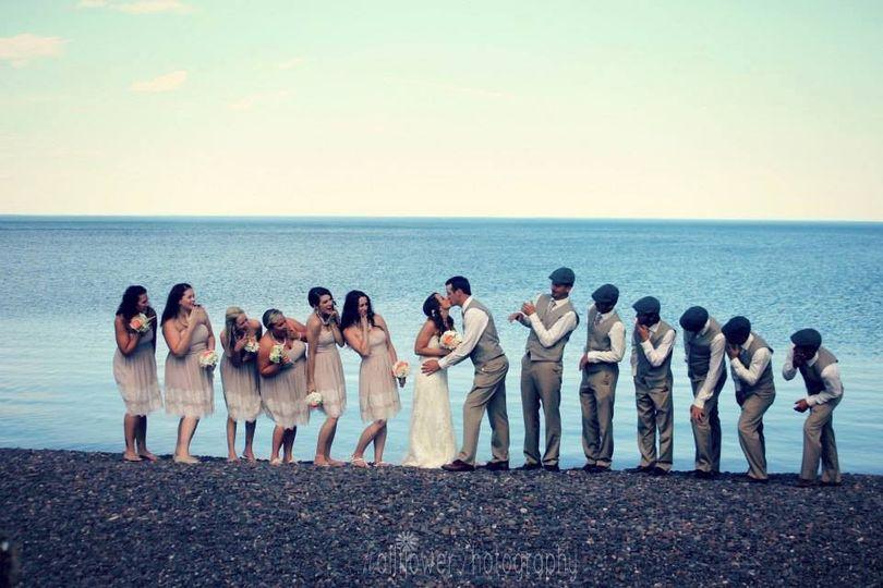 Fun kiss! Destination beach wedding on lake superior.