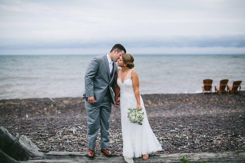Driftwood kiss! Lake superior beach wedding.