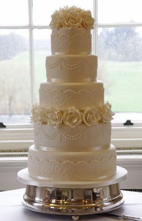 5 tier fondant ivory cake with sugar rose flowers