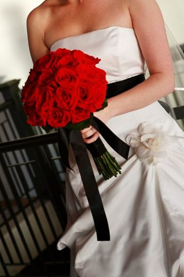 Style is all about accessorizing... the bride added the black ribbon to her gown and her bouquet is...